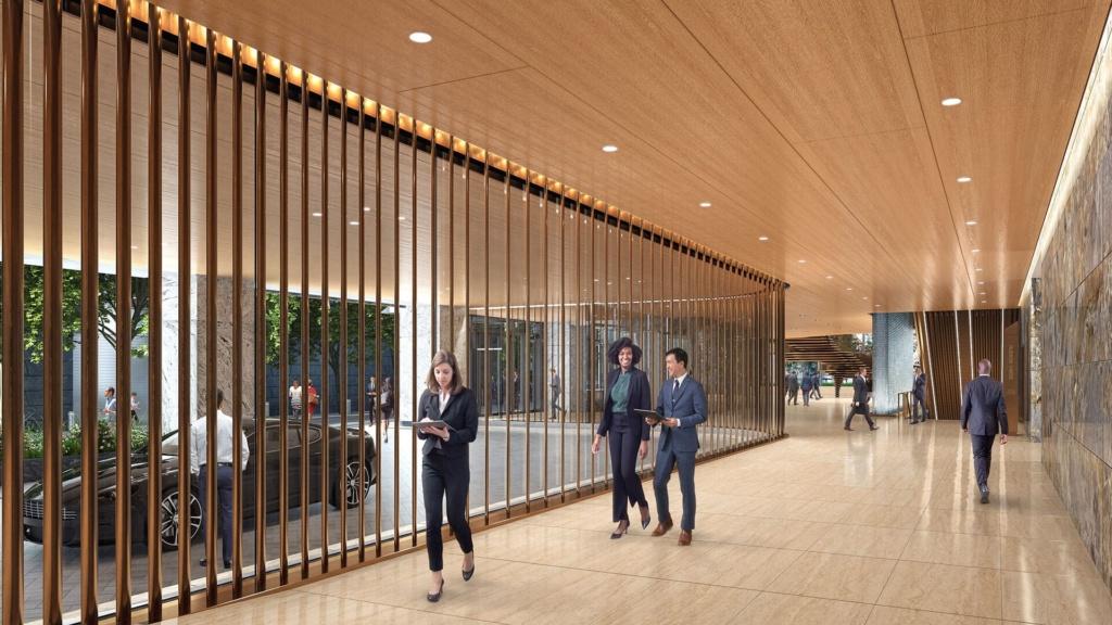 Business professionals walking down hallway at 50 Hudson Yards