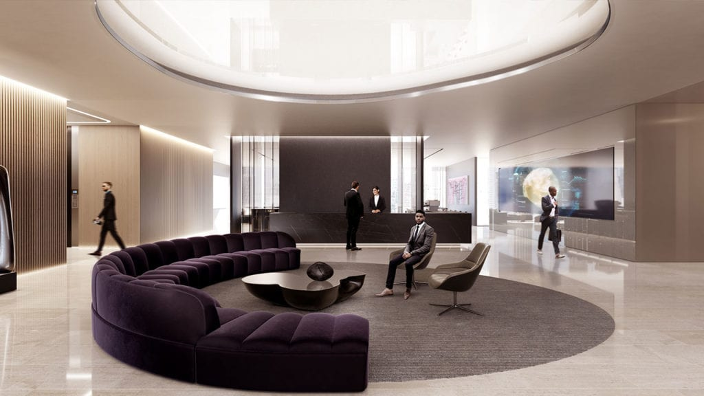 A luxurious and spacious lobby at 50 Hudson Yards. equipped with a circular couch and a transparent OLED screen.
