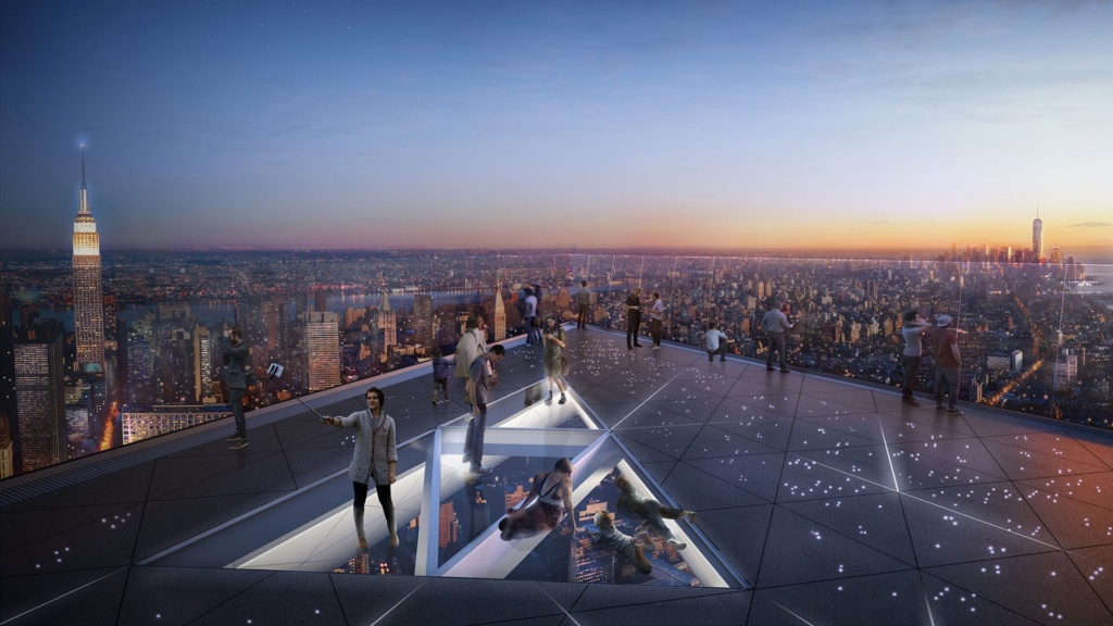 People take in the sight of Manhattan and New York City from The Edge observatory deck.