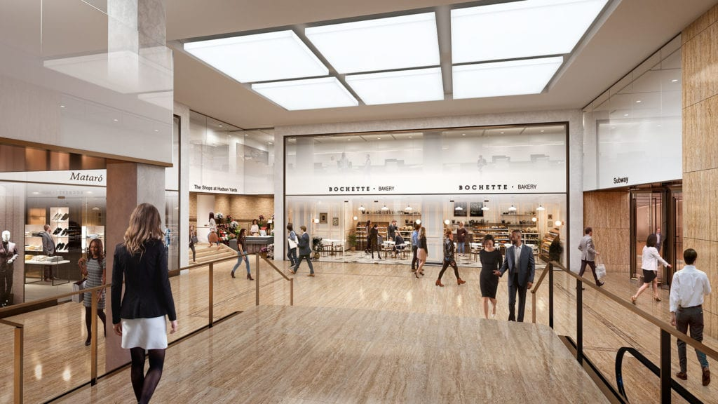 People walk by bakeries and designer stores while shopping at 50 Hudson Yards.