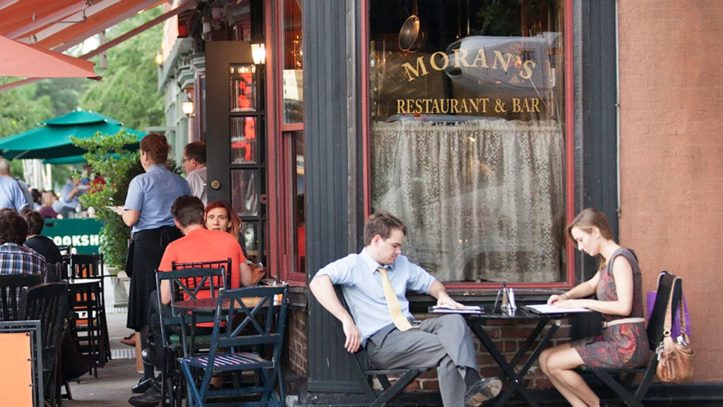 New Yorkers eat at tables outside Moran's restaurant and bar.
