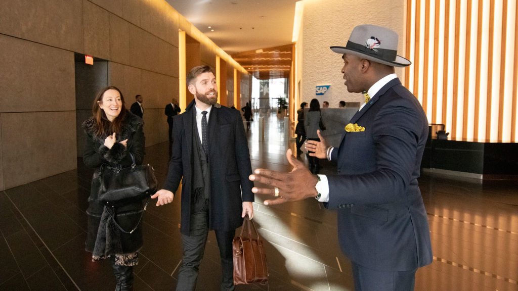 A lobby ambassador greets a couple in the lobby of 50 Hudson Yards.